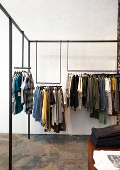 Using a single bar; you could add several different types of hanging racks. i.e. custom cascading arms and shelves can hang off of a simple beam. -easily stored and could be hidden inside a display or mobile store.