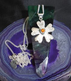 A personal favourite from my Etsy shop https://www.etsy.com/uk/listing/268787505/fine-silver-flower-pendant