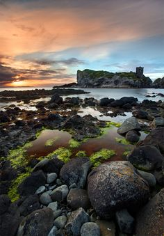 Kinbane Castle in County Antrim, Northern Ireland nestled on a long, narrow limestone headland and projecting out into the sea.  Approximately 5 km from Ballycastle on the road to Ballintoy. • Stephen Emerson