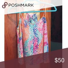 Lilly Silk Tank Silk racerback. Only worn a few times, will steam out wrinkles before shipping! Lilly Pulitzer Tops