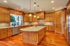 Traditional Kitchen with Pendant light, Undermount sink, Kitchen island, Simple Granite, Cabinet, Simple granite counters