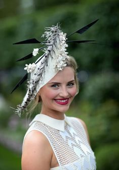 Butterflies, flowers and UMBRELLAS - this year's Ascot saw an extravagant array of headwear on display...