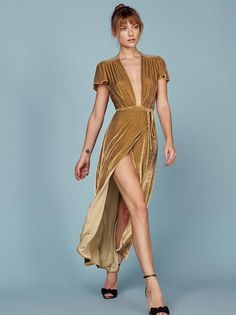 You'll find somewhere to wear it. This is an ankle length, wrap dress with a low v neckline and a cap sleeve.