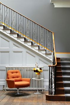 Plain and Classic - Victorian Gothic rails. Old cast iron radiators. I would have painted gold to make more of a feature.