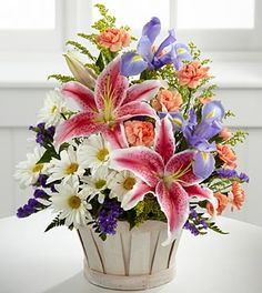 Pretty Mother's Day bouquet! https://www.ftd.com/flowers-pcg/the-wondrous-nature-bouquet-by-ftd-basket-included/occasion-mothersday-flowers/c12-4400/