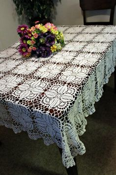 Scour the thrift shops for an old lace tablecloth for your booth at the baby fair.  Lace has an old-fashioned, traditional, feminine flair that would provide a strikingly different feel to your table.