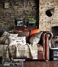 Leather sofa + brick walls = SOPHISTICATION ♥★I GUESS SO. I LOVE TWO TONE BRICK WALL.♥★