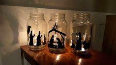 pesebre navideño en forma de tarros con velas, muy original y decorativo