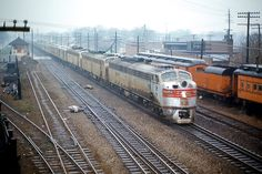 """Berwyn, Illinois: 19 APR'70 BN eastbound """"Morning Zephyr""""/""""Empire Builder""""/""""North Coast Limited"""" passes LaVergne depot. Photo by Paul Enenbach."""