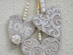 Thick MDF hearts using tissue paper, craft foam, roses and beads, raffia, cardboard, craft paint and dry brushing by Tina Schilling
