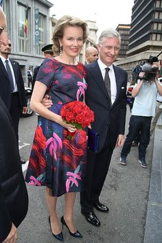 Queen Mathilde of Belgium and King Philippe of Belgium arrive for a prelude concert by the Belgian National Orchestra on the eve of Belgium's National Day, on 20 July 2015, at Bozar in Brussels.