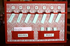 Altered cork board made into meal planner using scrapbook paper, ribbon, and painted clips and thumb tacs