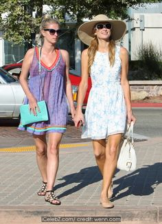 Paris Hilton  and sister Nicky Hilton shop at Malibu Country Mart http://icelebz.com/events/paris_hilton_and_sister_nicky_hilton_shop_at_malibu_country_mart/photo3.html