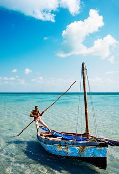 A man sailing a dhow in the waters around Benguerra Island