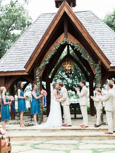 Callie and Chris are a couple after our own hearts! Not only did they celebrate their wedding day in true  Southern fashion–in cowboy boots and pearls, surrounde