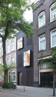 Skinny Rotterdam house for two architects features black brickwork and concealed windows
