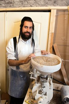 A new, organic shmura matzo is made from wheat and spelt grown on a Yiddish Farm in Goshen, N.Y. Yisroel Bass, the founder and director of the nonprofit farm and learning center, cultivates the grain on 40 acres, mills the flour and takes it to a kosher bakery in nearby Kiryas Joel. (Photo: James Estrin/The New York Times)