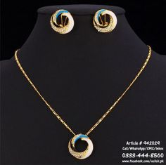 Necklace   Earrings Gold Plated Set with White, Black, golden, and Blue Strok