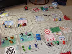 Preschool: Pretend Play Mat made from a shower curtain liner.  Draw roads with permanent marker and let students fill in the rest before driving their cars around.