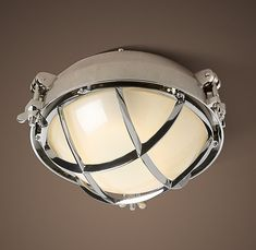 Circa 1900 Streamliner Flushmount contemporary ceiling lighting. This shiny chrome fixture looks like something straight off the Titanic. I would mount it in a mudroom or bathroom.