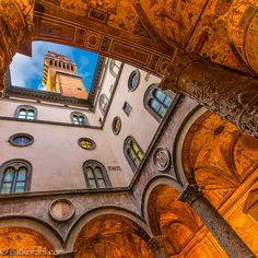 """The Palazzo Vecchio (Italian pronunciation: [paˈlattso ˈvɛkkjo] """"Old Palace"""") is the town hall of Florence, Italy. This massive, Romanesque, crenellated fortress-palace is among the most impressive town halls of Tuscany.  Caption and architectural photography by Pat Kofani."""