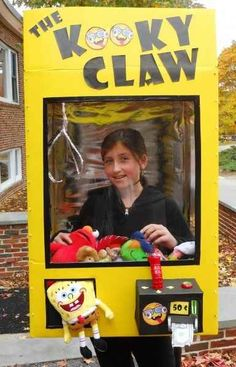 Keep it crazy in the claw machine. | 33 Super Easy Cardboard Box Halloween Costumes For Lazy People
