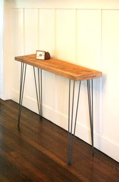 console table from reclaimed Douglas Fir timber with midcentury modern hairpin legs - modern industrial elemental. $300.00, via Etsy.