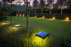 Lighting in a garden can be applied in various ways. From above with pole fixtures small or large. With tilting spots that you can focus on pots or on a lawn. Or with uplighters under trees. A combination of these various applications is applied in this garden.
