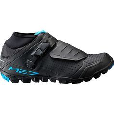 Striking a balance between XC lightness and enduro durability is no easy task, but Shimano is up to the challenge with its SH-ME7 Men's Cycling Shoes. They give all-mountain/enduro riders a lightweight option with ample protection and traction, without sacrificing responsiveness on the pedals.  The SH-M2E7 achieves its streamlined fit and consistent power transfer courtesy of its synthetic upper and stiff sole, which earns a rating of eight out of 12 on Shimano's stiffness index. Shimano…