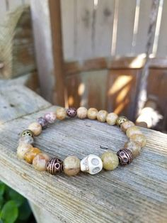 Check out this item in my Etsy shop https://www.etsy.com/listing/528704373/beaded-skull-stretch-bracelet-natural