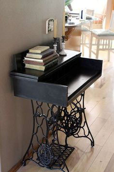 Desk with Singer sewing machine base.