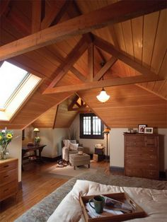 Love the odd angles, nooks/crannies, and leaving the beams so it doesn't feel small.