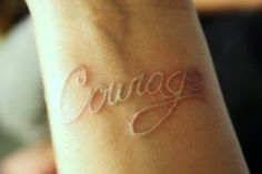 Pretty white ink tattoo, but real courage would have been getting it in neon ink.