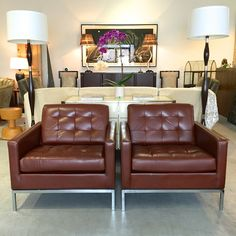 Pair of 1979 Florence Knoll leather lounge chairs.