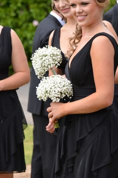 Bridesmaids carried babies breath bouquets