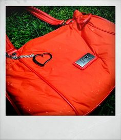 Pañalera Cloe $1000.(Naranja,morada) Incluye porta pañales, porta chupón, cambiador, porta biberón, stroller hooks