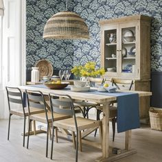 Patterned dining room with wooden furniture