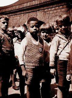 Massaquoi grew up a Liberian German child in Nazi Germany and later became the managing editor of Ebony Magazine. http://www.blackpast.org/aah/massaquoi-hans-jurgen-1926#sthash.QGhePWGK.qjtu