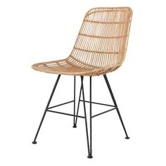 Beautiful rattan chair from Dutch brand HK Living. The chair has a strong metal frame around it is woven rattan and painted black or natural. Combine the chair with the colours in the same series to create a unique setting.