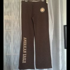 NWT AEO Brown Logo Sweatpants NWT American Eagle Outfitters brown logo sweatpants. Circular patch on upper left side and American Eagle ion right leg. Approximately 33 inch inseam and 16 inches across at top. Material 70% cotton, 30% polyester. American Eagle Outfitters Pants Track Pants & Joggers