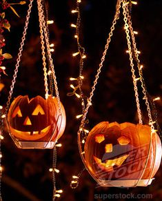 I like this...use a plant hanger for your pumpkins