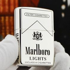 Regular Zippo Sterling Silver Marlboro Lighter $300  I really want this for my collection and it's my brand!