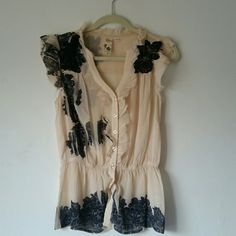 GUESS sexy sheer lace ruffle blouse Cream sexy sheer chiffon blouse, button up, elastic waistband hits right around natural waist. Black printed lace and stitched black lace too. Pretty ruffles on collar, sleeves, and around buttons. Guess Tops Blouses