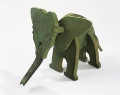 "Elephant Puzzle, c. 1927 - Alex Calder, american artist    Wood and paint  7 1/2"" x 13"" x 7 3/4""  Calder Foundation, New York; Bequest of Mary Calder Rower, 2011  A19484"