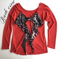 Gauzy thin boatneck sweater Reddish-orange and slightly see-through (see up close photo.) There are a few very minor snags thanks to the gauzy material and jewelry. The price reflects same. I wore this top twice. Tops