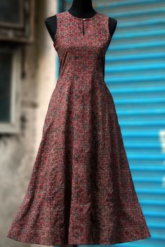 a perfect maxi dress in auburn ajrakh in flowy style! this dress has mangalgiri fabric in the button and at the base within the dress! 100% cotton fabric, han