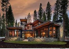 mountain homes A modern mountain aesthetic delineates the design of this home located along the putting corse. A mix of stone, steel and timber elements. Make this house perfect. Dream Home Design, Modern House Design, Modern Mountain Home, Mountain Home Exterior, Dream House Exterior, Cabin Homes, House Goals, Black House, Future House