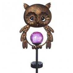 'Whoo'' wants to have some delightful nighttime fun in the garden? A small solar panel attached to this owl garden stake provides all the power for the LED light within the mesmerizing crackle glass orb. Placed along a walkway, beside the front porch or amongst the flower garden, this metal owl looks great during the day and welcomes your garden guests with a lovely touch of colorful lights at night. Give this thoughtful Precious Moments garden stake as a 'thinking of yo...