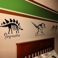 Wall stripes and vinyl dinosaur decals in Jack's bedroom.  #DIY #KidsBedroom #Dinosaurs