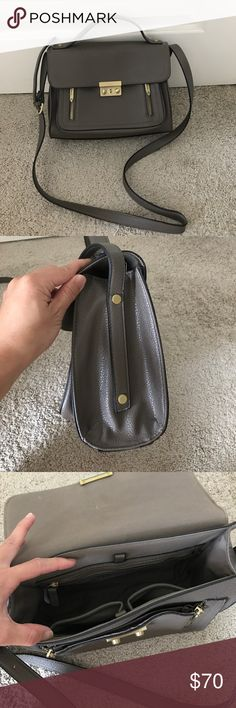 Phillip Lim 3.1 for Target bag Phillip Lim for Target strap bag. Gray with gold clasp and zippers. Two interior pockets. 8in high 10.5in wide. 3.5in on bottom wide at its widest point. Adjustable strap. Barely used. Practically new! 3.1 Phillip Lim Bags Shoulder Bags